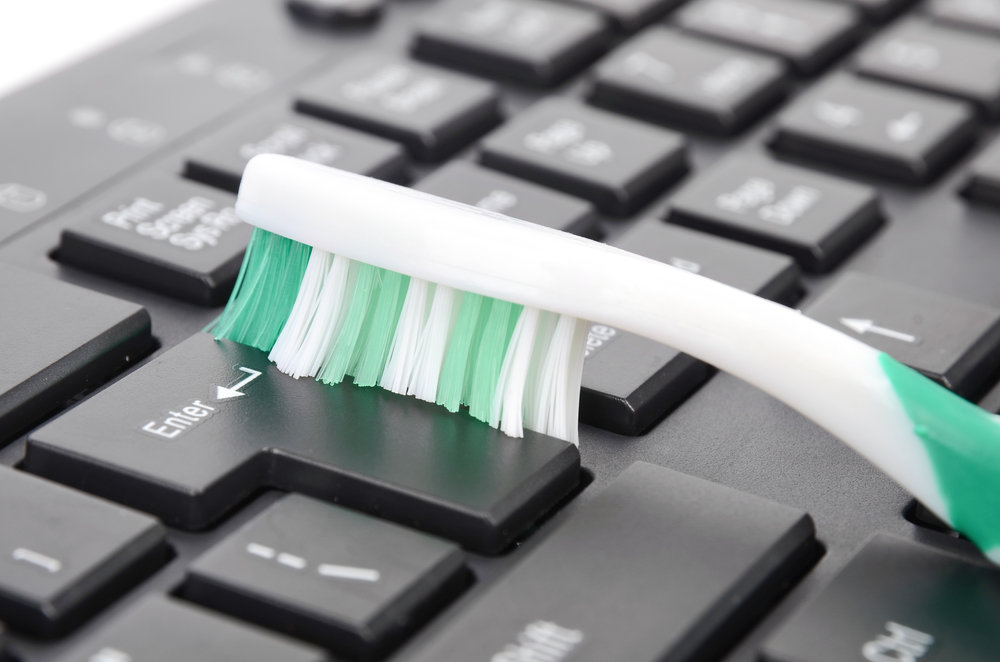Clean Your Keyboard With A Toothbrush
